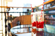 Leinwandbild Motiv Summer refreshing lemonade with rasberry on a balcony of terrace