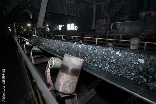 Vászonkép Black coal on a conveyor belt