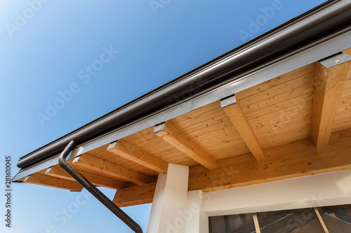 Fényképezés Rain gutter on the roof ecological house