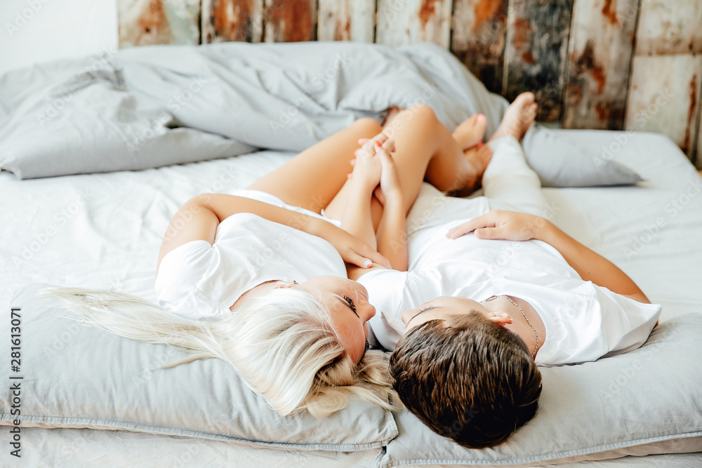 Fototapeta top view of beautiful young couple in love hugging and lying together