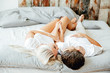top view of beautiful young couple in love hugging and lying together