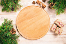 Pizza Cutting Board At Table Background With Christmas Decoration, Round Board. New Year Concept