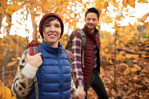 Attractive caucasian couple hiking through the forest in the fall in Canada Fototapeta