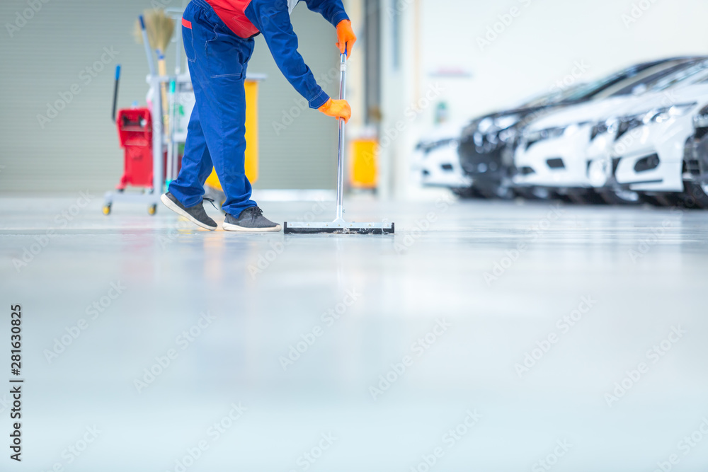 Fototapety, obrazy: Car mechanic repair service center cleaning using mops to roll water from the epoxy floor. In the car repair service center.