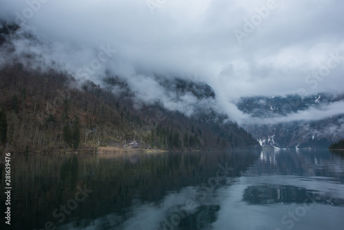 Poster Chocolate brown Tranquil scene of Konigssee lake in Germany in foggy day with a hut on the shore
