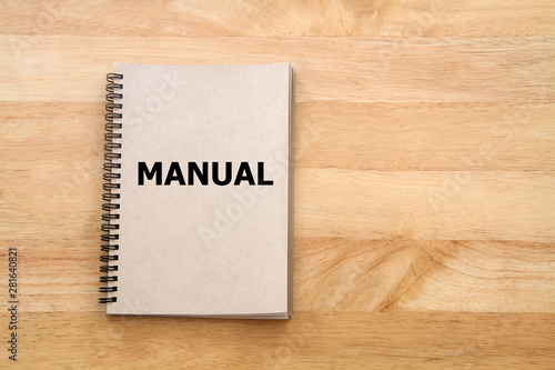 Valokuvatapetti User manual or Instruction manual book on wooden desk
