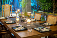 Dinner Set On The Wood Table With Long Wine Glass