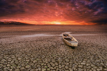 Wooden Rowboat On Cracked Soil...