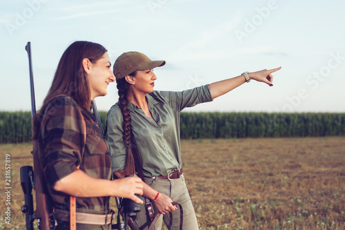 Two friends hunting watching wild. Canvas Print