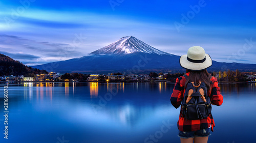 Wall Murals Kyoto Woman traveler with backpack looking to Fuji mountains in Japan.