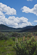 The Wide Open Sagebrush Filled Desert Valley In The Utah Countryside.