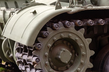 Front Part Of A Heavy Tracked Tank With A Wing And A Caterpillar With A Gear Wheel. Military Conflict Concept