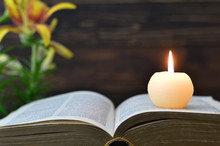 Candle, Book And Flowers On Wo...