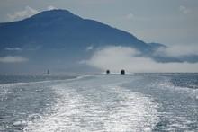 Two Boats Fishing Off Alaskan Coastline