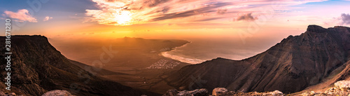 Fototapeta Amazing summer sunset panorama over ocean resort beach Famara Lanzarote Canary Islands, Spain obraz