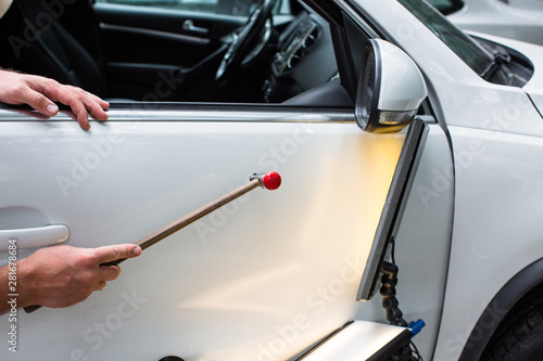 Pinturas sobre lienzo  Repairing car dent after the accident by paintless dent repair