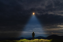 The UFO Shines On A Male Standing On The Mountain
