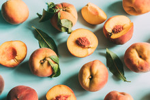 Top View On Fresh Ripe Peaches On Bright Blue Background. Harvest This Summer, Delicious Juicy Fruits.