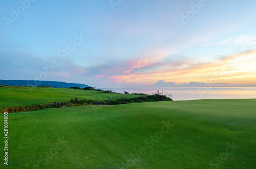 Fototapety, obrazy: Sunset on a green golf course