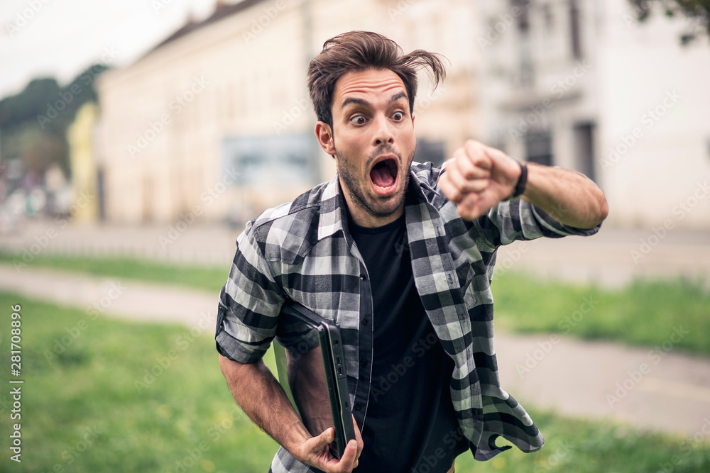 Fototapety, obrazy: Young and attractive urban guy being late for his appointment