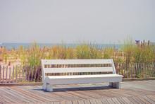 Empty Bench On The Boardwalk
