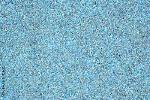 A structured background from light blue plaster Fototapeta