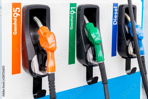 Colorful Petrol pump filling nozzles isolated on white background , Gas station in a service in warm sunset. Head fuel vehicle refueling facility in asia