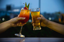Couple Celebration In Restaurant With Soft Drink Beer And Mai Tai Or Mai Thai - Happy Lifestyle People With Soft Drink Concept