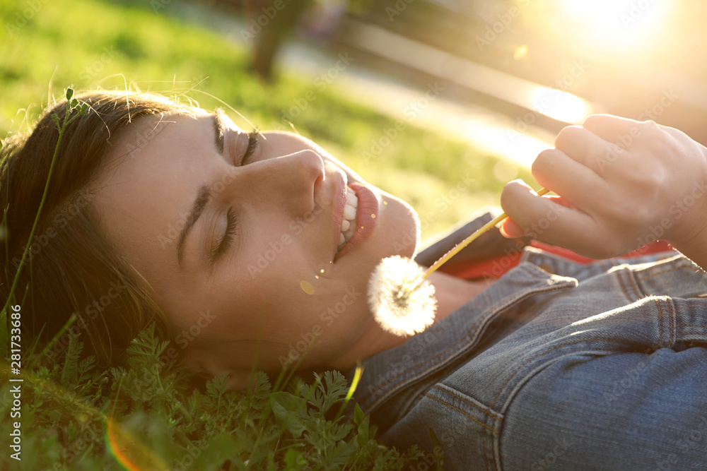 Fototapety, obrazy: Young woman with dandelion in park on sunny day. Allergy free concept