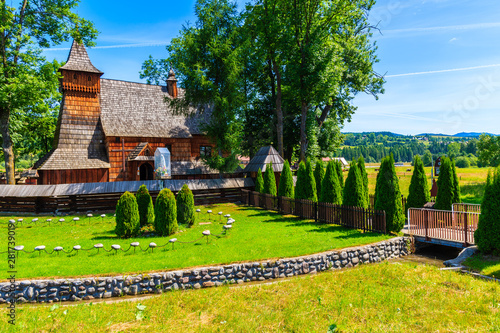 Old wooden church listed on Unesco list in Debno village on sunny summer day, Poland - fototapety na wymiar