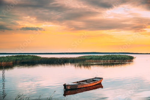 Türaufkleber Landschaft Braslaw Or Braslau, Vitebsk Voblast, Belarus. Wooden Rowing Fishing Boat In Beautiful Summer Sunset On The Dryvyaty Lake. This Is The Largest Lake Of Braslav Lakes. Typical Nature Of Belarus