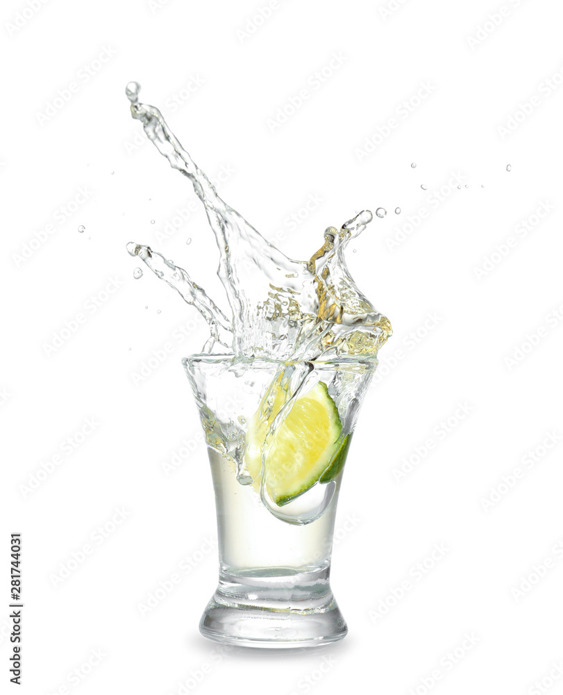 Fototapety, obrazy: Dropping of lime into glass with tasty tequila on light background