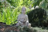 statue of buddha in natural garden