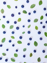 Blueberries And Small Green Le...