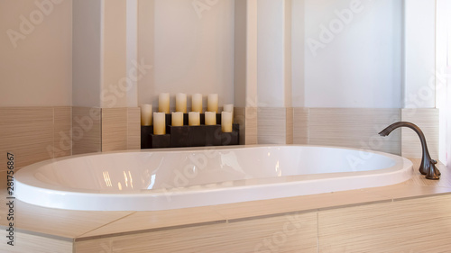 Fotografija Panorama frame Bathroom interior with close up view of a gleaming oval shaped bu