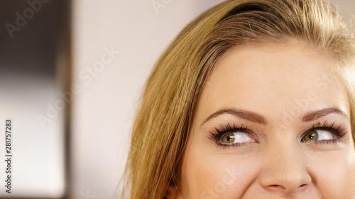 Half of woman face. Young female and her eyes Billede på lærred