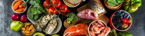 Fototapeta Pescetarian diet plan ingredients, healthy balanced grocery food, fresh fruit, berries, fish and shellfish clams,  black background copy space  obraz