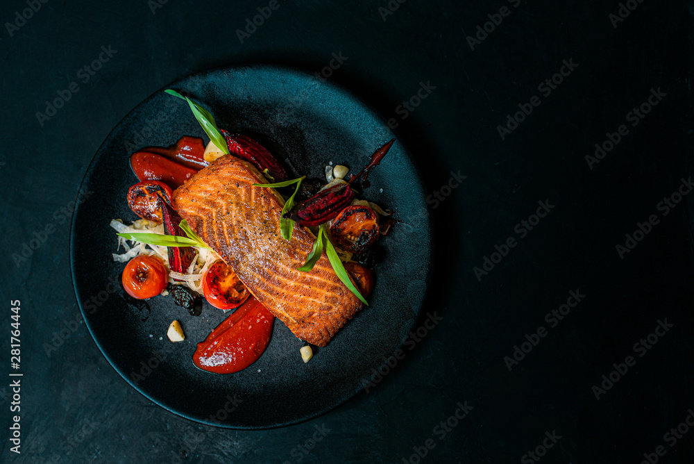 Fototapety, obrazy: Delicious meal on a black plate, top view, copy space.