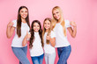 Photo of four different age ladies hugging raising thumbs up wear casual outfit isolated pink background