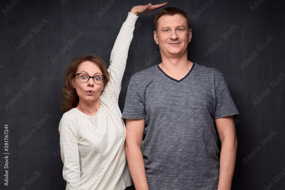 Fototapeta Shot of funny short woman and tall man
