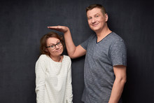 Shot Of Funny Tall Man And Short Woman