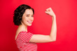 Leinwandbild Motiv Photo of rejoicing wavy curly woman after having done two pushups while isolated with red background