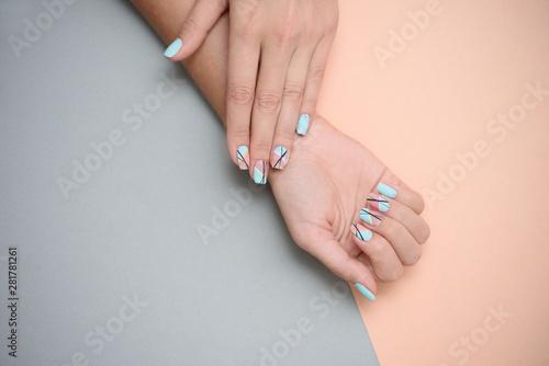 Fotografiet  Beautiful female manicure on a pastel color background.