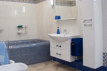 Modern Luxury Bathroom With Large Bath Tub And Mosaic Tiles