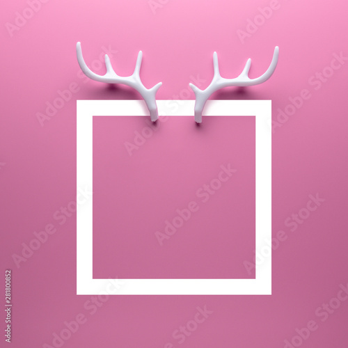White reindeer antlers on bright pink background. Minimal New Year or Christmas concept. Flat lay.