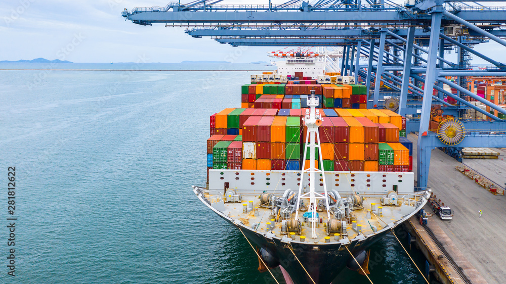 Fototapety, obrazy: Cargo ship terminal, Unloading crane of cargo ship terminal, Industrial port with containers and container ship.