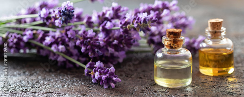Foto op Aluminium Lavendel Panoramic header of essential oil bottles and lavender