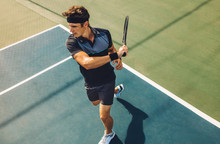 Tennis Player Hitting Powerful Forehands In A Game