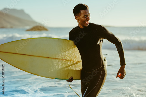 Smiling african male surfer - 281828847