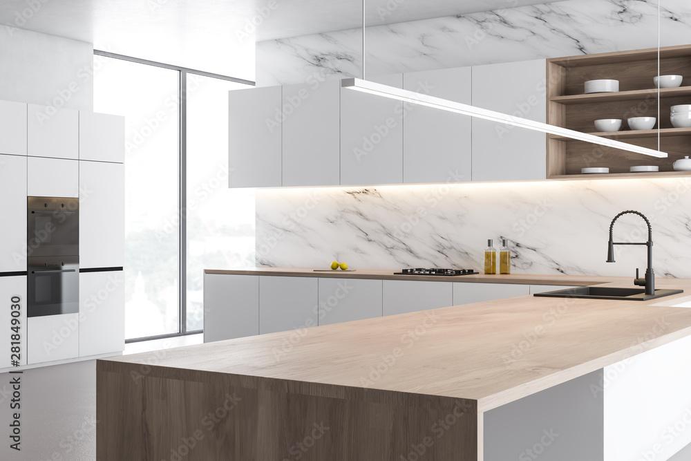 Fototapeta White marble kitchen corner with wooden island